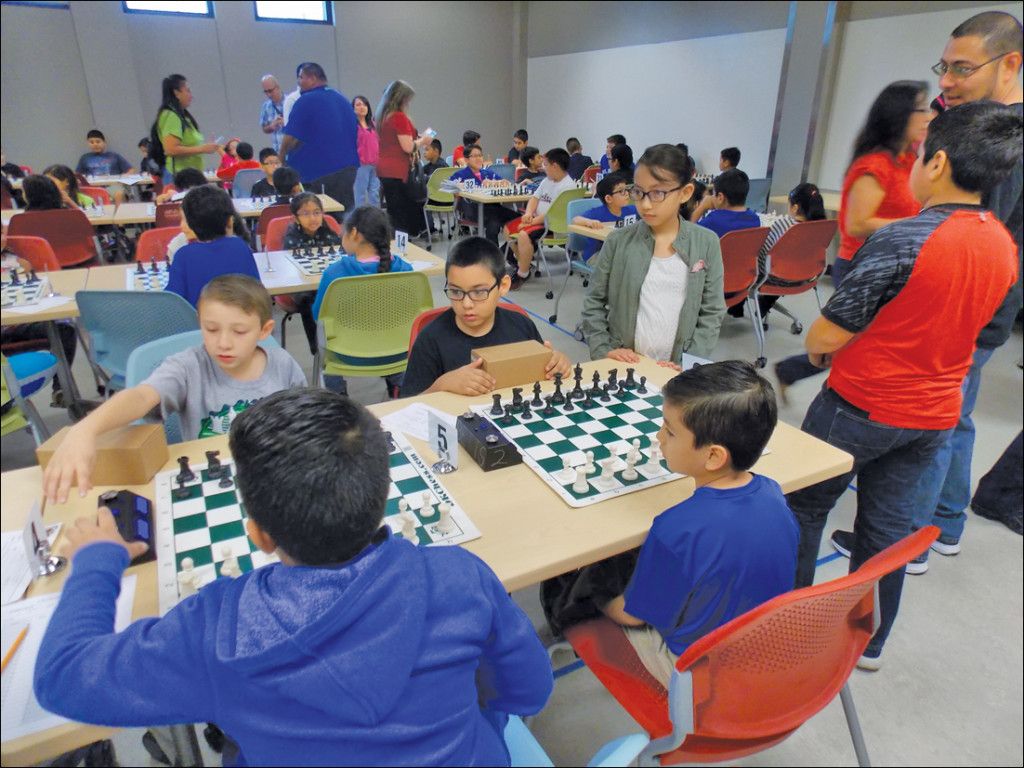 Students play against each other during the tournament that is set up for the last day of the chess summer camp so that students can know what a real chess tournament is like. COURTESY PHOTO