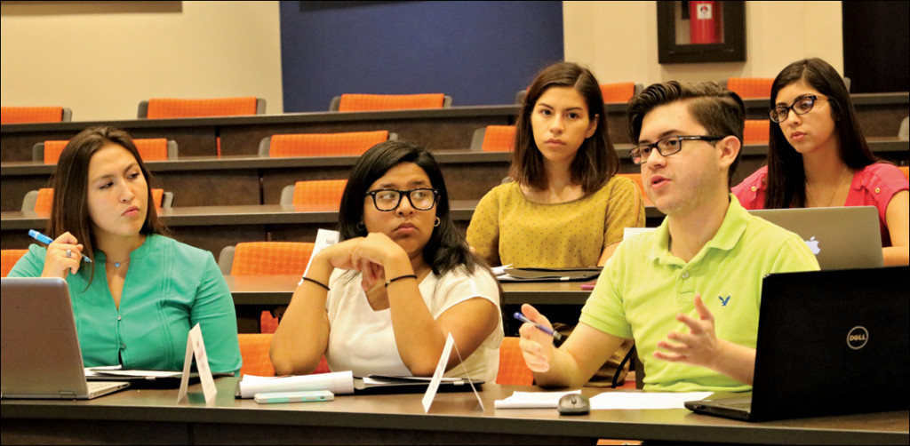 Senator At-Large Ernesto Farias (right) asks a question to Student Government Association President Denisse Molina-Castro during a meeting Sept. 9 on the Brownsville campus. The senate discussed the 2016-2017 SGA budget during new business. MICHELLE ESPINOZA/THE RIDER