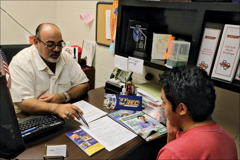 Jaime Villanueva, senior program coordinator for career education, advises mathematics sophomore Dennis Rodriguez on his résumé June 16 in the Career Center office in Brownsville. MICHELLE ESPINOZA/ THE RIDER