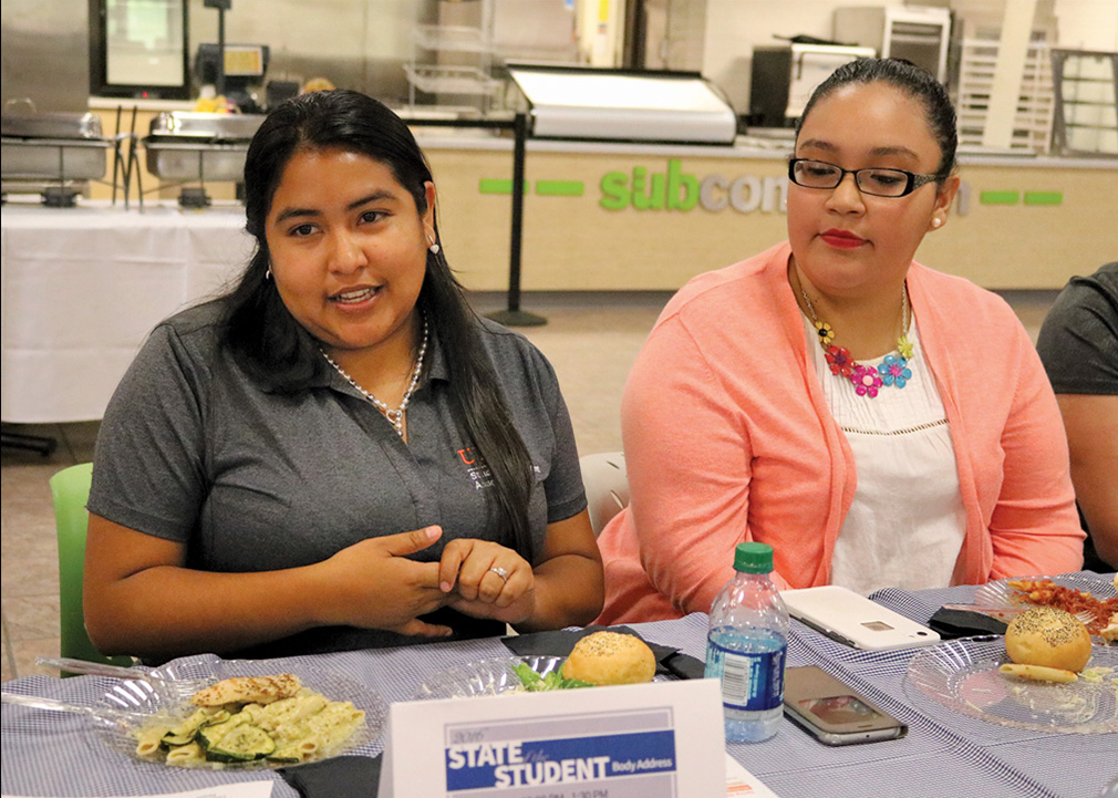 Student Government Association President Denisse Molina-Castro (left) discusses plans to collaborate with other campus organizations during the SGA President's Luncheon, held Aug. 16 on the Brownsville campus. Also shown is Rebeca Rodriguez, a bystander peer educator for the Superhero Project./Michelle Espinoza/The Rider