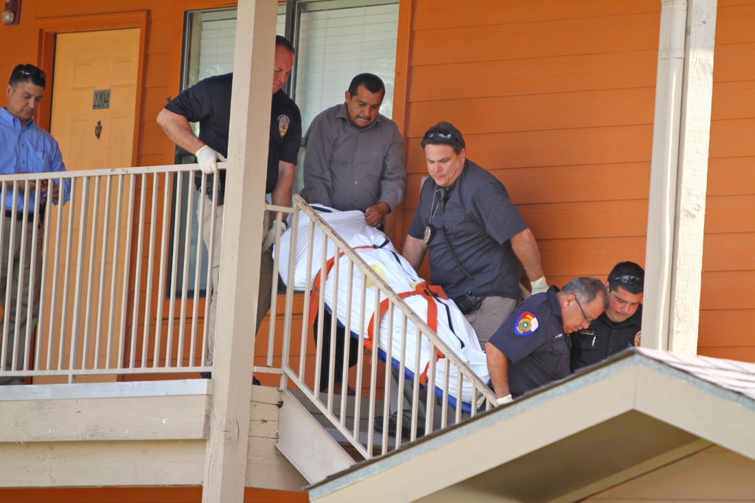The body of a 20-year-old UTRGV student is removed from The Village apartments in Edinburg. LESLEY ROBLES/THE RIDER