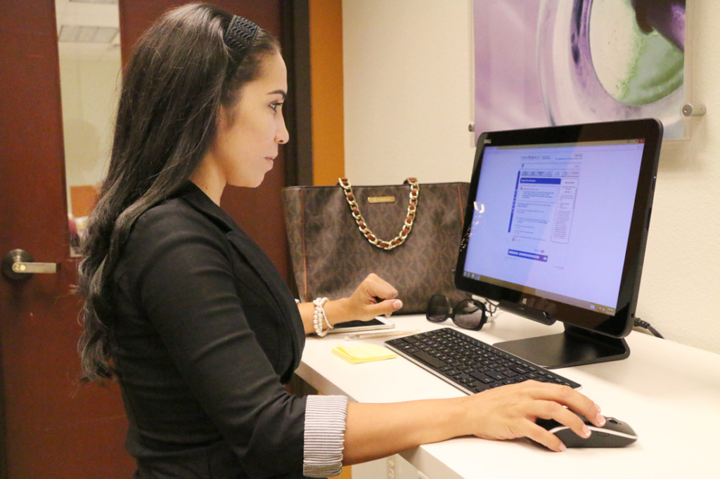 Aurora Benavides, who has an associate's degree in respiratory therapy checks her transfer credits to enroll at UTRGV last Thursday at The Tower in Brownsville./Ana Cahuiche/ The Rider