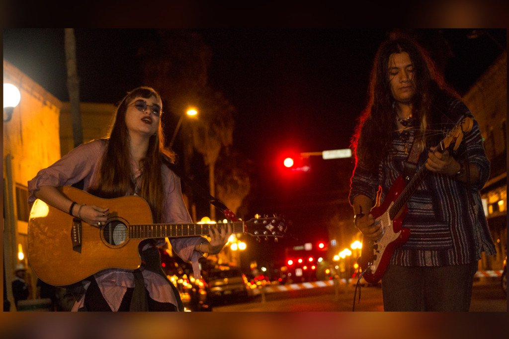 Jewel Marie (left) and Adrian Puente from local folk band The Blitz perform for the audience during the Downtown Brownsville Walkabout –Last One For The summer!/Mario Gonzalez/ The Rider