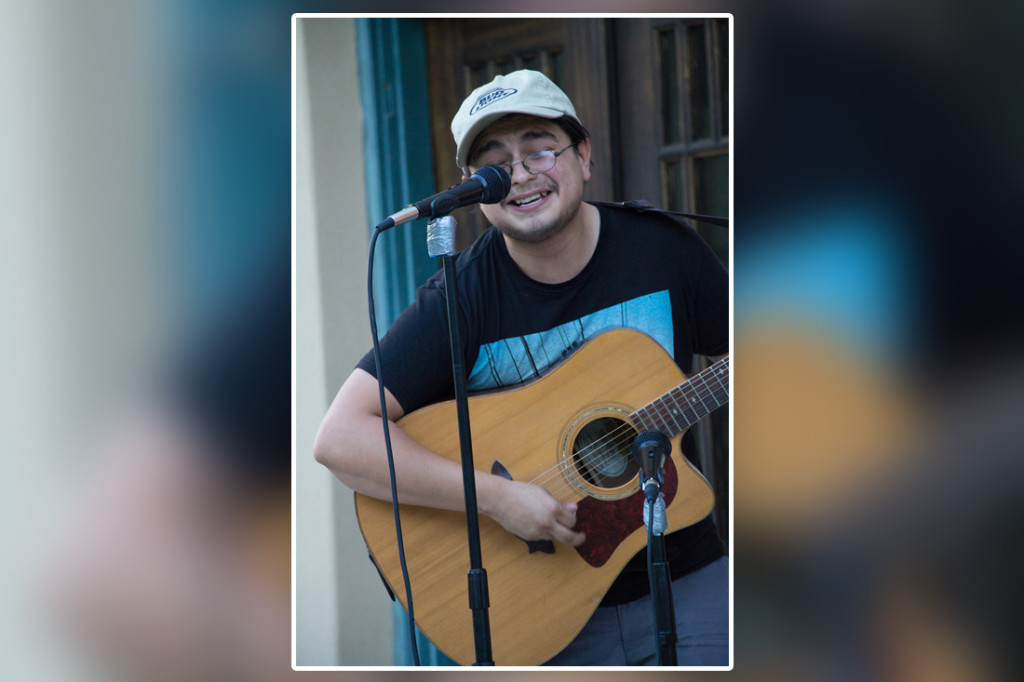 Andrew Mendoza, lead singer for the band In Shades, performs at the Frontera Audubon's acoustic night on the lawn. Musicians were invited to perform acoustic sets last Tuesday as an audience sat on the lawn of Frontera Audubon in Weslaco, where food was sold and donations were accepted./Gabriel Mata/The Rider.