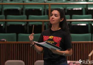 """Theatre senior and student director Sabrina Rodriguez guides the actors as they rehearse their lines for the play, """"Get Out and Play: A Play About Playing,"""" which will be performed in the Albert L. Jeffers Theatre on the Edinburg campus."""