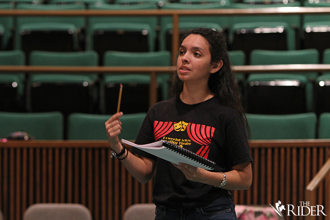 "Theatre senior and student director Sabrina Rodriguez guides the actors as they rehearse their lines for the play, ""Get Out and Play: A Play About Playing,"" which will be performed in the Albert L. Jeffers Theatre on the Edinburg campus."