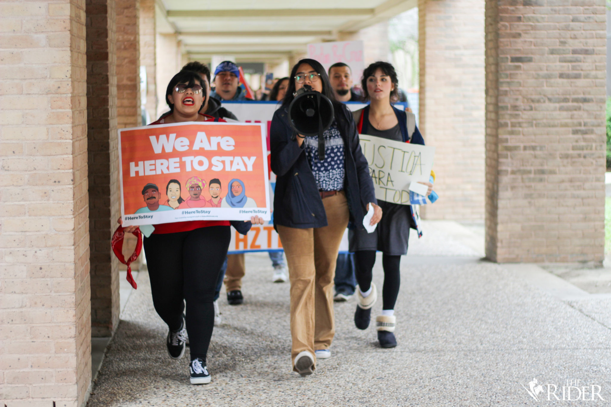 "UTRGV students march earlier today through the Bronc Trail on the Edinburg campus to voice their displeasure with President Donald Trump's rescindment of the DACA program. Protesters urged UTRGV administration to create a Dreamer Center during the rally of the ""Solidarity Walkout."""