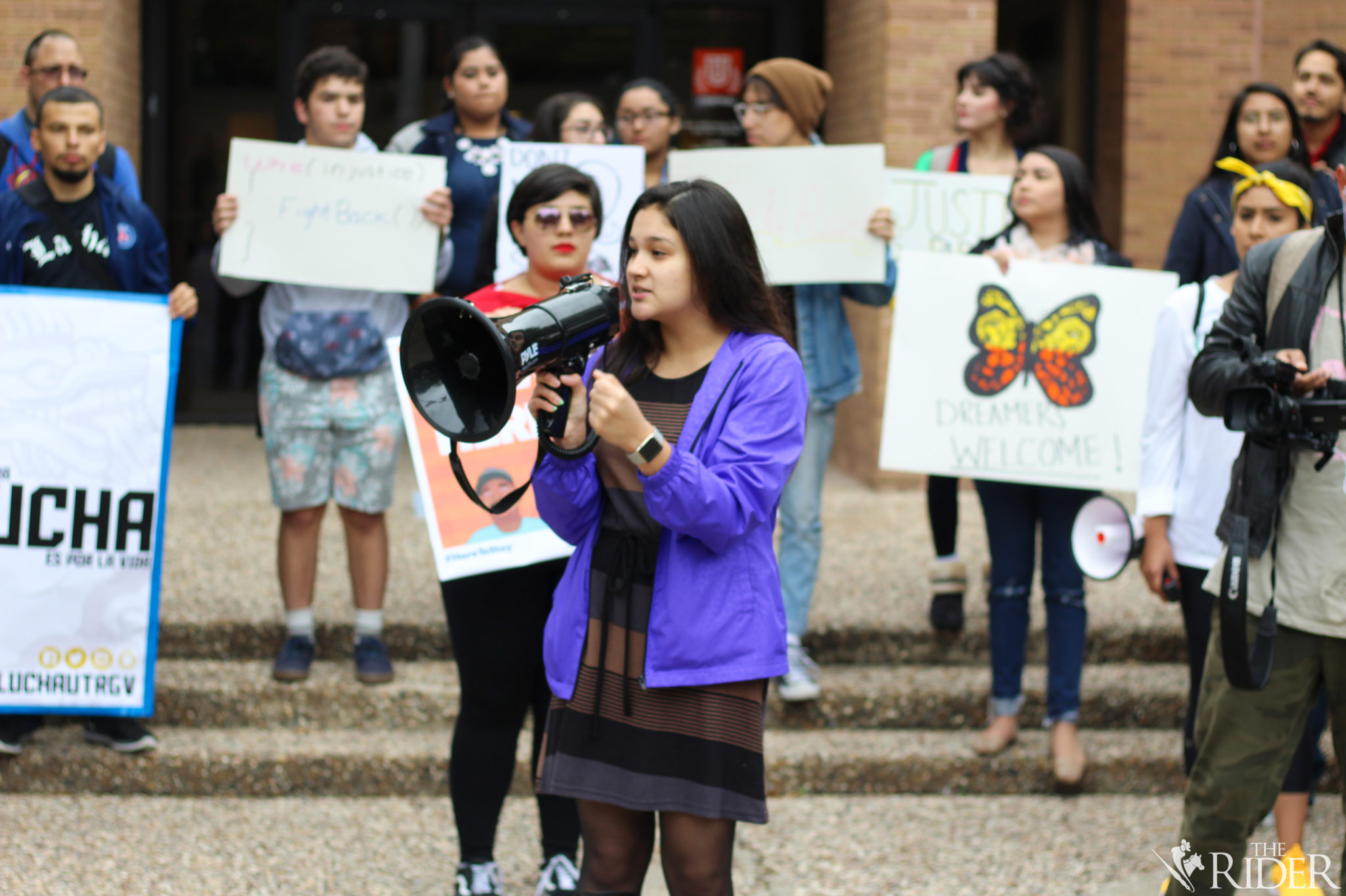 """Alondra Galvan, president of the UTRGV Student Government Association, speaks during the rally of the """"Solidarity Walkout."""" Protesters asked Galvan if the SGA can pass a resolution to create a Dreamer Center at UTRGV. She responded by saying she and the SGA are willing to meet with students."""