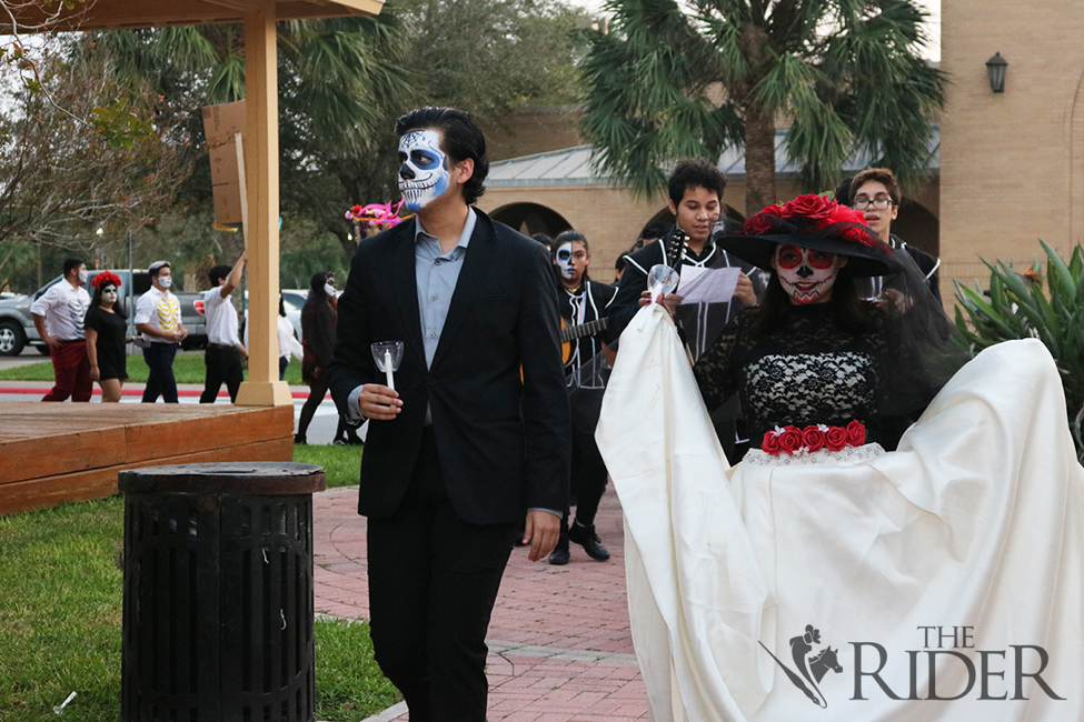 Texas Southmost College sophomore Eros Lujano and senior Vyktoria Olivares lead the Day of the Dead parade.