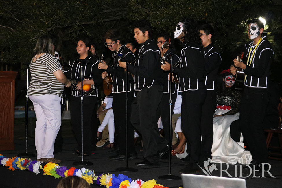 After the parade, students provide live music followed by a PowerPoint presentation on Day of the Dead altars.
